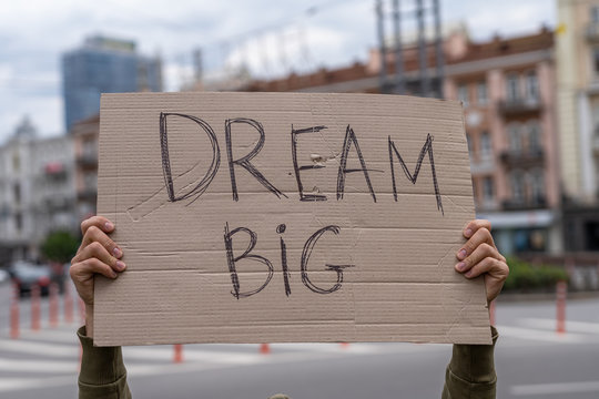 Motivation positive thinking sign. Dream big. self development and achievement goals theme. Social public messages on banners outside on streets.  reflection phrases self love. support