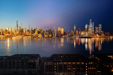 Fototapete - New York City skyline day night