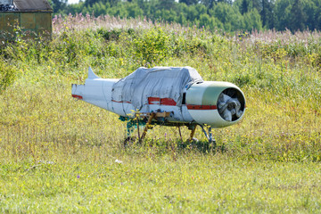 the remains of an old aircraft stand in a meadow on a Sunny summer day