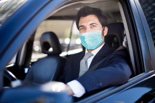 Masked man driving his car