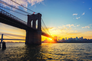 View on Brooklyn bridge and Brooklin at vibrant sunrise, New York City