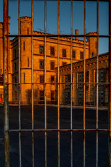 Old prison through jail bars