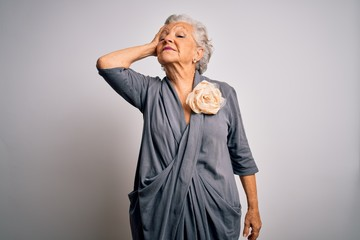 Senior beautiful grey-haired woman wearing casual dress standing over white background smiling confident touching hair with hand up gesture, posing attractive and fashionable Fotobehang