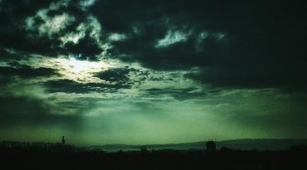 Foto auf Gartenposter Olivgrun Silhouette Landscape Against Sky At Dusk