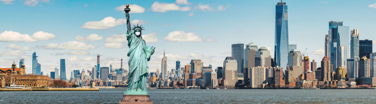 The Statue of Liberty wearing surgical mask when Covid-19 Outbreak over panorama of New york cityscape river side