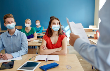 education, healthcare and pandemic concept - group of students wearing face protective medical...