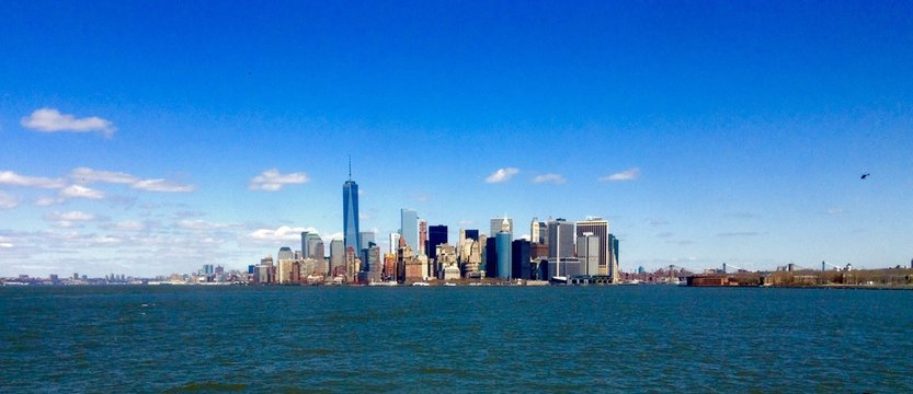 One World Trade Center By Lake Against Sky In City