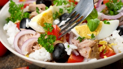 Wall Mural - mixed vegetable salad with rice, tuna, egg, tomato and olive