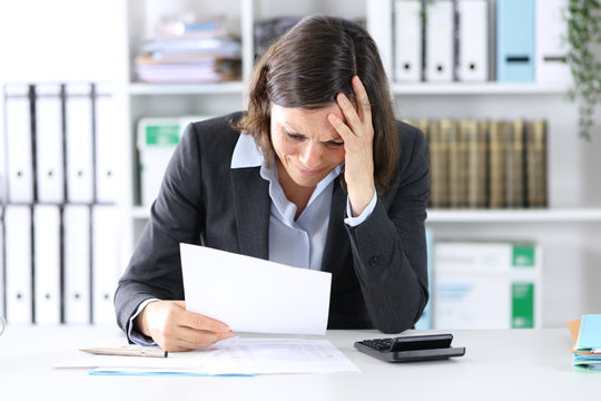 Sad executive lady complaining about bad results at office