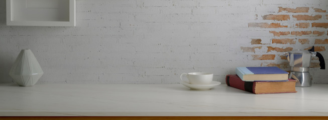 Wall Mural - Close up view of trendy workspace with coffee cup, books and copy space