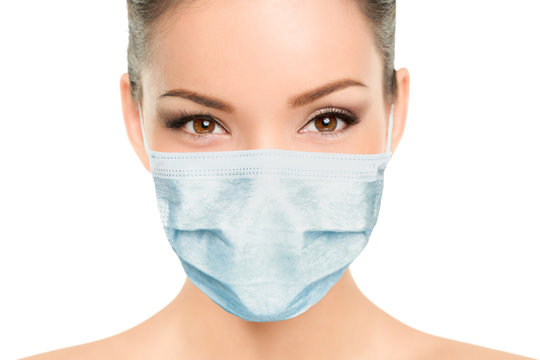 Beautiful Asian woman wearing medical face mask with eyes makeup beauty model portrait isolated on white background for Coronavirus.
