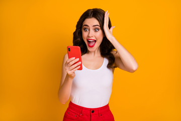 Photo of funky crazy millennial lady open mouth hold telephone read positive blog post comments hand on head wear casual white singlet red skirt isolated yellow color background