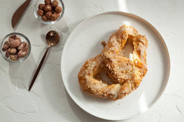 sweet pretzel with icing and nuts, sweet pastries