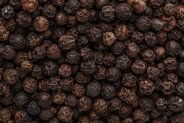 Fotobehang Hot chili peppers Peppercorn background. Dry black pepper seeds. Top view. Flat design. Macro spice background