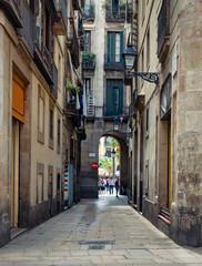 Old narrow street in Barcelona, Catalonia, Spain. Architecture and landmark of Barcelona. Cozy cityscape of Barcelona