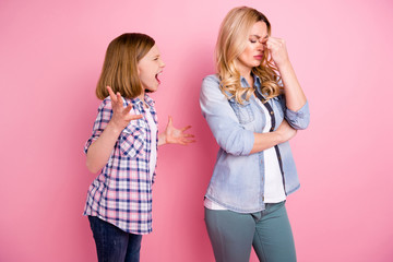 Frustrated two people aggressive kid girl yell scream mother touch nose suffer headache hate family misunderstanding wear denim jeans checkered plaid shirt isolated pastel color background