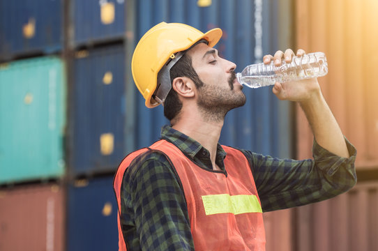 Worker is drinking water after finishing work