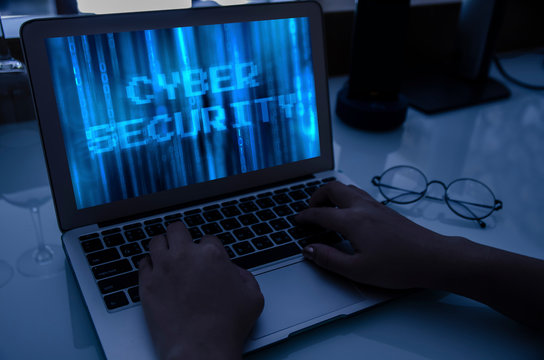System security specialist work from home by remote access for prevent hacker to attack the system. Hack, darkness, virtual reality and science fiction. Matrix background with cybersecurity concept.