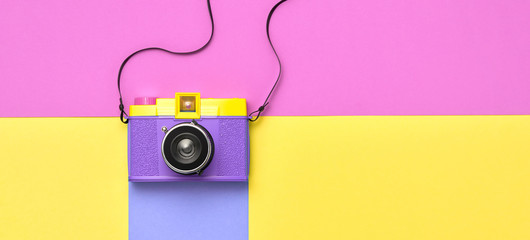 Fashion film camera. Minimal hipster summer trend flat lay. Retro design camera on vivid color. Summertime concept. Trendy fashionable film camera, creative pop art