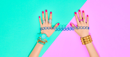 Fashion. Trendy jewelry, female hands, accessories set. Minimal design. Stylish wrist watches,...