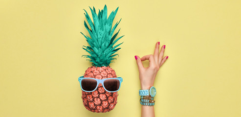 Fashion. Pineapple hipster in sunglasses, sfemale hand, OK gesture. Minimal concept, summer tropical pineapple. Creative art fashionable concept. Summertime color, pineapple OK banner