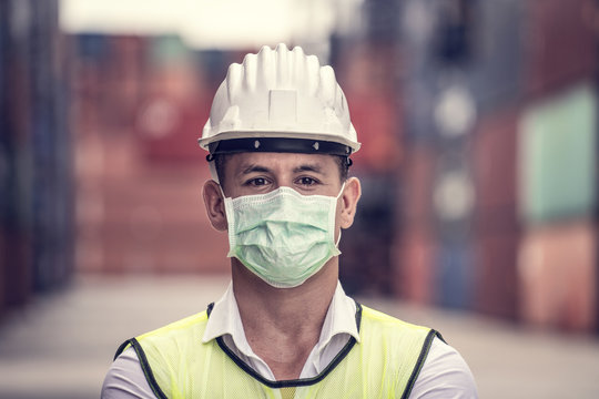 Coronavirus Disease or COVID can spread easily without mask. Quarantined masked workers protect spreading of Covid 19 by wearing face masks. Workers are engineer wear masks during quarantine time