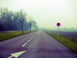 Foto auf Gartenposter Aubergine lila Empty Road Along Countryside Landscape