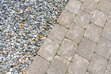 Tumbled paver walkway in the garden with mulch create an interesting landscaping abstract background.
