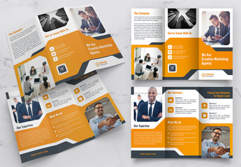 Trifold Brochure Layout with Orange Accents