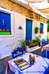 Typical street restaurants (taverns) of Greece. Paxos. Ionian island of Greece