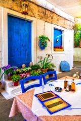 Typical street restaurants (taverns) of Greece. Paxos.IOnian island of Greece