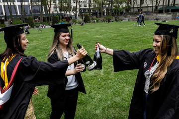 Molloy College Nursing School graduates: Taylor Laufer, Yuliya Dubyna and Gabriela Rivas make a toast in Bryant Park in New York