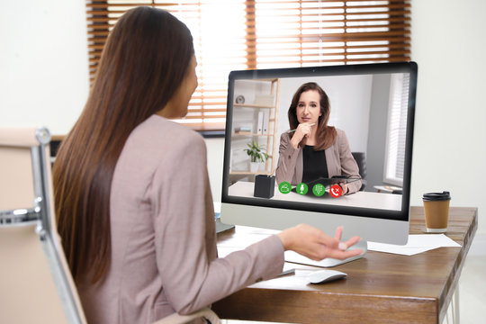 Woman using video chat for online job interview in office