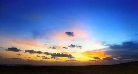 Foto auf AluDibond Dunkelblau View Of Landscape Against Cloudy Sky