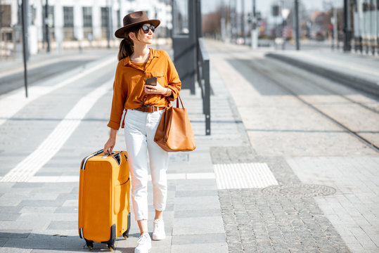Woman with a suitcase on the city street