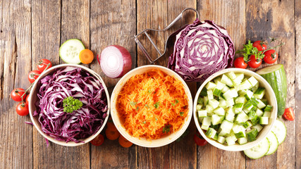 Wall Mural - assorted of vegetable salad, cabbage, cucumber and grated carrot