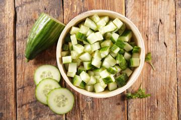 Wall Mural - fresh cucumber salad on wood background