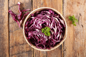 Wall Mural - fresh cabbage salad on wood background