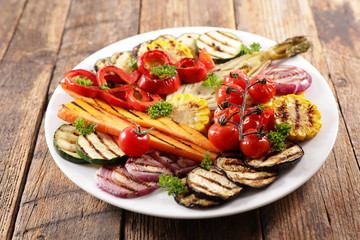 Wall Mural - grilled colorful vegetables, aubergine, zucchini, bell pepper, celery, onion, corn with basil