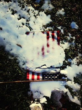 Close-up Of Snowed American Flag On Ground