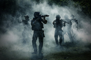 Military Historical reconstruction soldiers fighting during. US Army soldier soldiers in a cloud of smoke. Fotomurales