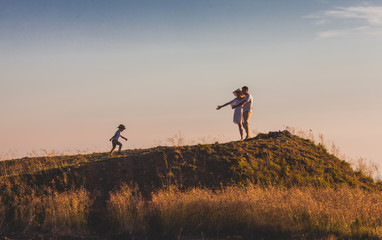 Couple waiting their son on a hill