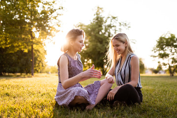 Women in park having a healthy discussion
