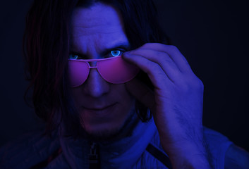 Retro wave portrait of cyborg young man with glowing eyes.