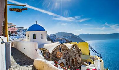 Fototapeten Santorini Church In Oia At Santorini By Aegean Sea Against Sky