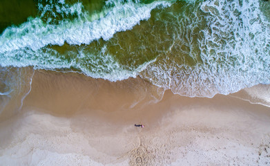 Aerial view of waves crashing on the shoreline in Perdido Key beach