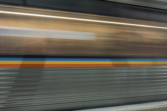 Moving subway train passing quickly in underground station in downtown Atlanta
