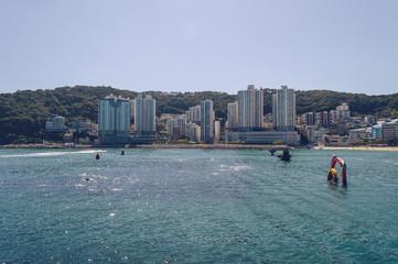 sparkling sea and buildings surrounding Songdo beach