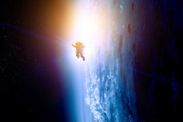 Fototapete - Astronaut at spacewalk . Mixed media