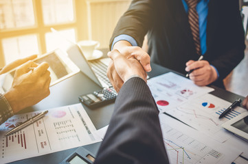 Business people shake hands after agreeing to cooperate with business